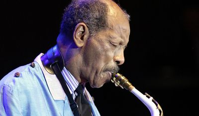 """FILE - In this Wednesday, Feb. 14, 2007, file photo, U.S. jazz legend Ornette Coleman plays the sax during his only concert in Germany at the philharmonic concert house in Essen, Germany. Coleman, the visionary saxophonist who pioneered """"free jazz"""" and won a Pulitzer Prize in 2007,  died, on Thursday, June 11, 2015 in New York. He was 85. (AP Photo/Martin Meissner, File)"""