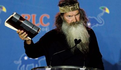 "Duck Dynasty"" patriarch Phil Robertson will receive the ""Andrew Breitbart Defender of the First Amendment Award"" at the Conservative Political Action Conference Friday. (Associated Press photographs)"