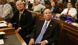 Kansas House Taxation Committee Chairman Marvin Kleeb, front right, R-Overland Park, and other members of the house watch as votes are tallied Wednesday night, June 10, 2015. (Bo Rader/The Wichita Eagle via AP) ** FILE **