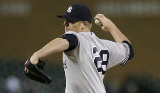 New York Yankees relief pitcher David Carpenter throws during the eighth inning of a baseball game against the Detroit Tigers, Wednesday, April 22, 2015, in Detroit. (AP Photo/Carlos Osorio)