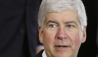 FILE - This June 20, 2014 file photo shows Michigan Gov. Rick Snyder during a ceremony in Detroit. Mr. Snyder on Thursday, June 11, 2015 signed a law letting private adoption agencies with state contracts decline to participate in referrals against their religious beliefs, despite criticism that it amounts to government-sanctioned discrimination against gay couples. (AP Photo/Carlos Osorio, file)