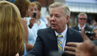 Sen. Lindsey Graham, South Carolina Republican and 2016 presidential hopeful, greets supporters in Central, S.C., on June 1, 2015. (Associated Press) **FILE**