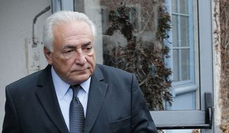 Former Managing Director of International Monetary Fund Dominique Strauss-Kahn leaves his hotel in Lille, northern France, as he goes on trial for sex charges at a court in this Feb. 11, 2015, file photo. (AP Photo/Christophe Ena, File)
