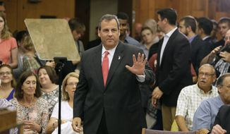 New Jersey Gov. Chris Christie waves to supporters before speaking about education reform, Thursday, June 11, 2015, at Iowa State University in Ames, Iowa. (AP Photo/Charlie Neibergall)