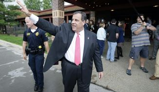 New Jersey Gov. Chris Christie waves to supporters after visiting with customers at the Hickory Park Restaurant, Thursday, June 11, 2015, in Ames, Iowa. (AP Photo/Charlie Neibergall)