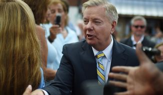 Sen. Lindsey Graham, South Carolina Republican and presidential hopeful, greets supporters in Central, S.C., on June 1, 2015. (Associated Press) **FILE**