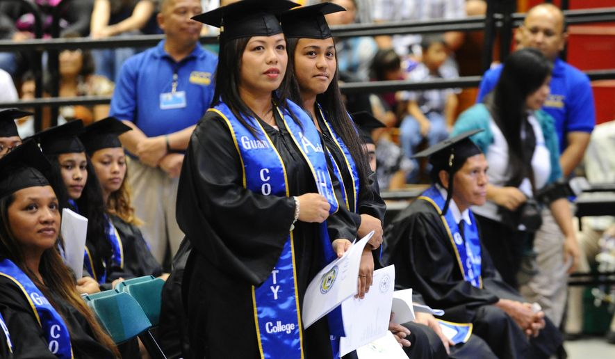 ADVANCE FOR THE WEEKEND - In this May 19, 2015 photo, Genevie Chiguina, 40, left, and her daughter Genaray Chiguina, 21, wait for their turn to receive their Adult High School diplomas during the Guam Community College's 38th commencement exercise held on May 19, 2015, at the University of Guam Calvo Field House in Mangilao, Guam. The women both became pregnant at 16 and dropped out of high school. Genevie Chiguina led by example by enrolling in GCC's Adult High School program and encouraging her daughter to take the program as well. The two passed the GED, a high school equivalency test, and graduated together.  (Rick Cruz/Pacific Daily News via AP)