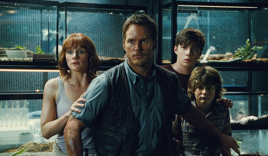 """This photo provided by Universal Pictures shows, Bryce Dallas Howard, from left, as Claire, Chris Pratt as Owen, Nick Robinson as Zach, and Ty Simpkins as Gray, in a scene from the film, """"Jurassic World,""""directed by Colin Trevorrow. (Universal Pictures/Amblin Entertainment via AP)"""