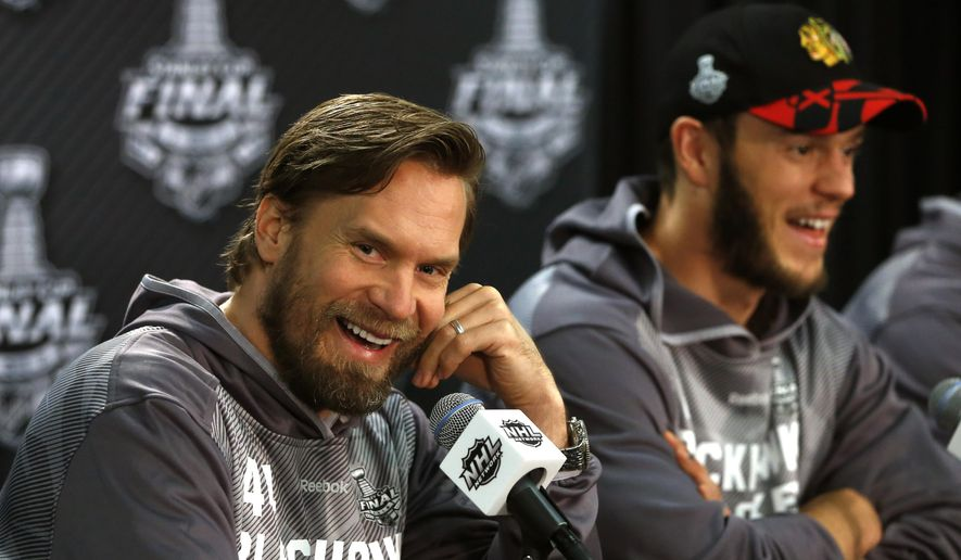 Chicago Blackhawks defenseman Kimmo Timonen, left, and center Jonathan Toews, laugh during an NHL hockey Stanley Cup Final news conference Wednesday, June 10, 2015, in Chicago. The Blackhawks will face the Tampa Bay Lightning in Game 5 on Saturday in Tampa. (AP Photo/Charles Rex Arbogast)
