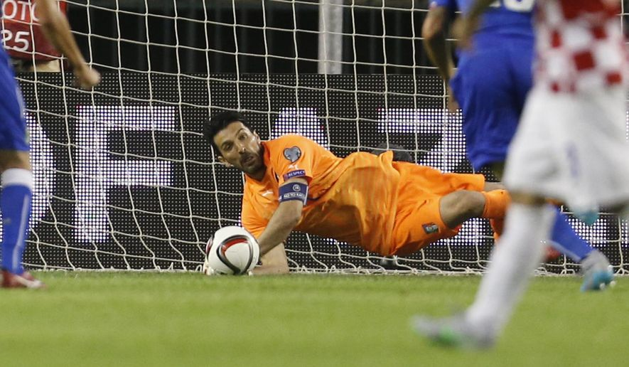 Italy's goalkeeper Gianluigi Buffon saves a penalty shot during the Euro 2016 Group H qualifying soccer match between Croatia and Italy, in Split, Croatia, Friday, June 12, 2015. (AP Photo/Darko Bandic)
