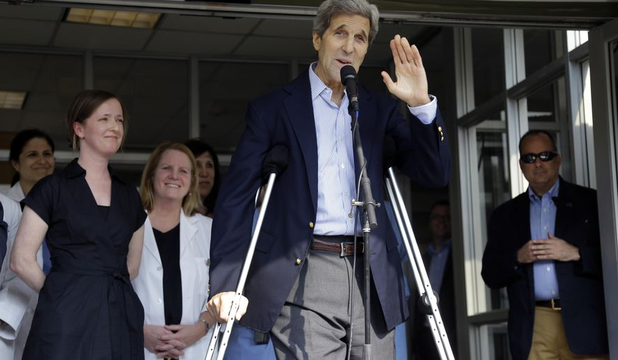 Secretary of State John Kerry waves after speaking to media as he is discharged from Massachusetts General Hospital Friday, June 12, 2015, in Boston. Kerry was released from the hospital after undergoing surgery on a broken leg sustained in a May 31 bicycle accident in France. (AP Photo/Elise Amendola)