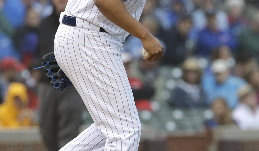 Chicago Cubs closer Hector Rondon kicks the mound during the 10th inning of a baseball game against the Cincinnati Reds, Friday, June 12, 2015, in Chicago. The Reds won 5-4. (AP Photo/Nam Y. Huh)