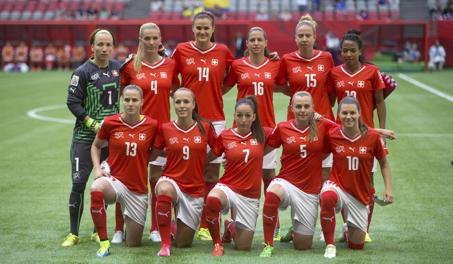 Switzerland players pose for a team photo before playing Ecuador during a FIFA Women's World Cup soccer match in Vancouver, British Columbia, on Friday, June 12, 2015. (Darryl Dyck/The Canadian Press via AP)
