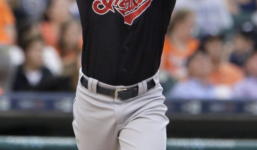 Cleveland Indians' Ryan Raburn reacts after hitting a fly ball in the fourth inning for an out against the Detroit Tigers of a baseball game Friday, June 12, 2015, in Detroit. The Tigers defeated the Indians 4-0. (AP Photo/Duane Burleson)