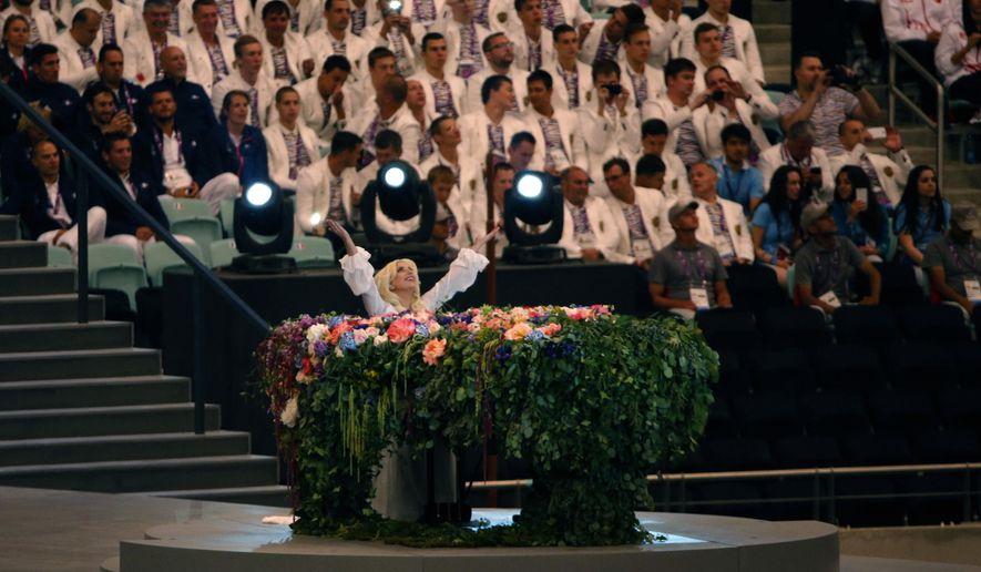 US singer Lady Gaga gestures, during the opening ceremony of the 2015 European Games, in Baku, Azerbaijan, Friday, June 12, 2015. (AP Photo/Dmitry Lovetsky)