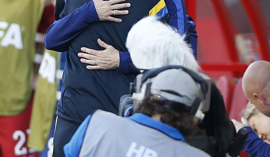 United States head coach Jill Ellis and Sweden head coach Pia Sundhage embrace prior to FIFA Women's World Cup soccer action in Winnipeg, Manitoba, Canada, Friday, June 12, 2015. (John Woods/The Canadian Press via AP) MANDATORY CREDIT