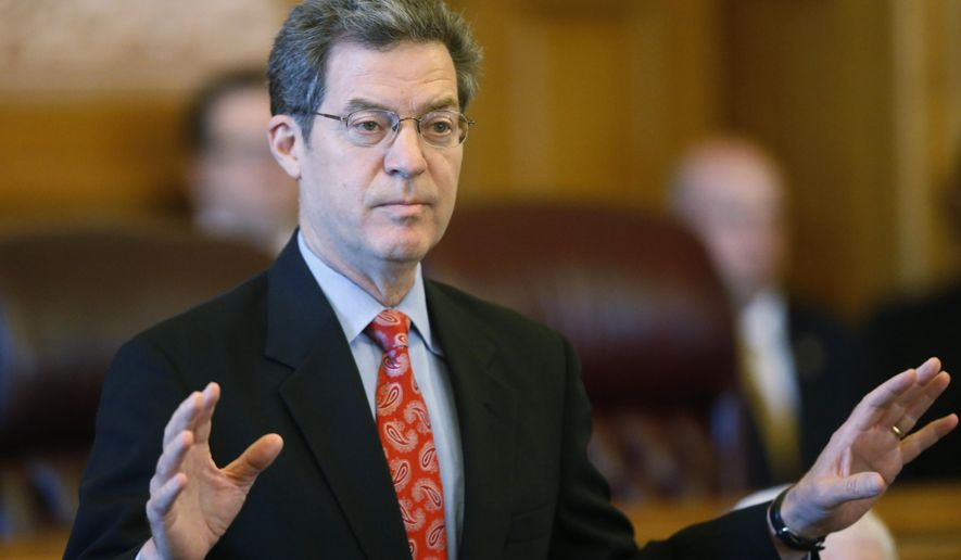 Kansas Gov. Sam Brownback addresses a joint caucus of the Kansas Senate and House republicans, Thursday, June 11, 2015 in Topeka, Kan. Kansas faced the prospect of deep cuts to schools, prisons and other programs after the Republican-controlled House soundly rejected a proposal supported by Brownback that would hike sales and cigarette taxes to close a budget deficit. (Bo Rader/The Wichita Eagle via AP) LOCAL STATIONS OUT; MAGS OUT; LOCAL RADIO OUT; LOCAL INTERNET OUT