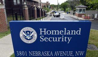 A gate leading to the Homeland Security Department headquarters in northwest Washington is seen here on June 5, 2015. (Associated Press) **FILE**