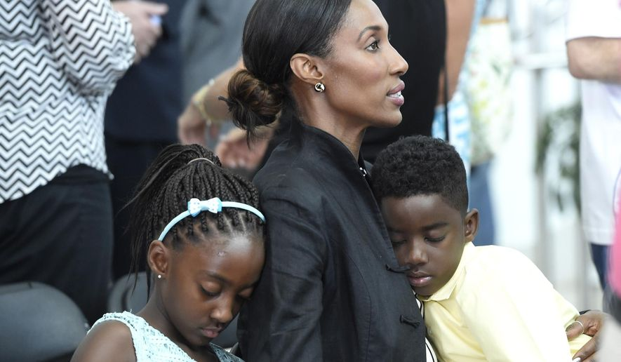 Former WNBA basketball player Lisa Leslie, center, cradles her son, Michael Joseph Lockwood II, as he and sister Lauren Jolie Lockwood nap against their mother following a ceremony renaming the the South Rotunda of the Women's Basketball Hall of Fame in honor of Pat Summitt, former Tennessee women's basketball coach on Friday, June 12, 2015 in Knoxville, Tenn. Leslie will be inducted into the Women's Basketball Hall of Fame on Saturday night. (Adam Lau/Knoxville News Sentinel via AP)