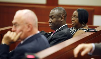 Attorney Benjamin Crump, center, sits in a courtroom with Patty King, right, Friday, June 12, 2015, in Las Vegas. B.B. King's family members have brought in Crump, a prominent national lawyer, to review the events surrounding the blues icon's death and estate. (AP Photo/John Locher)