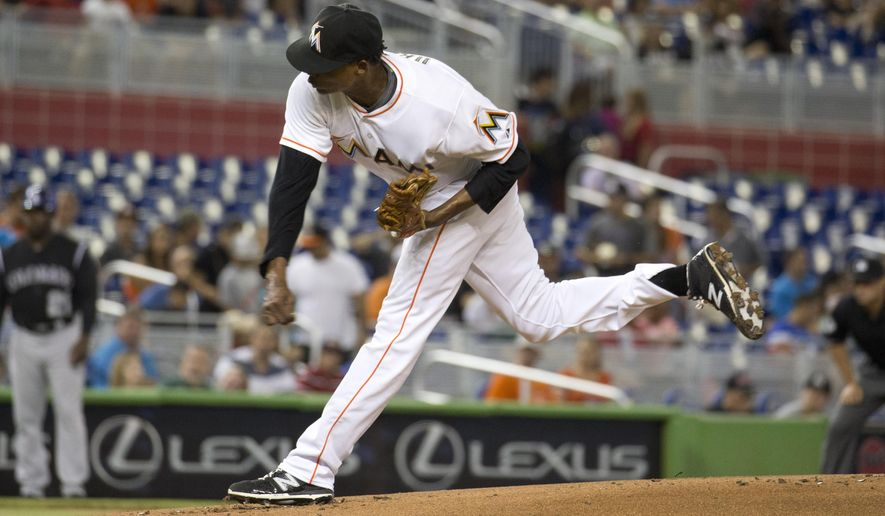Miami Marlins pitcher Jose Urena (62) throws to the Colorado Rockies during the first inning of a baseball game in Miami, Friday, June 12, 2015. (AP Photo/J Pat Carter)