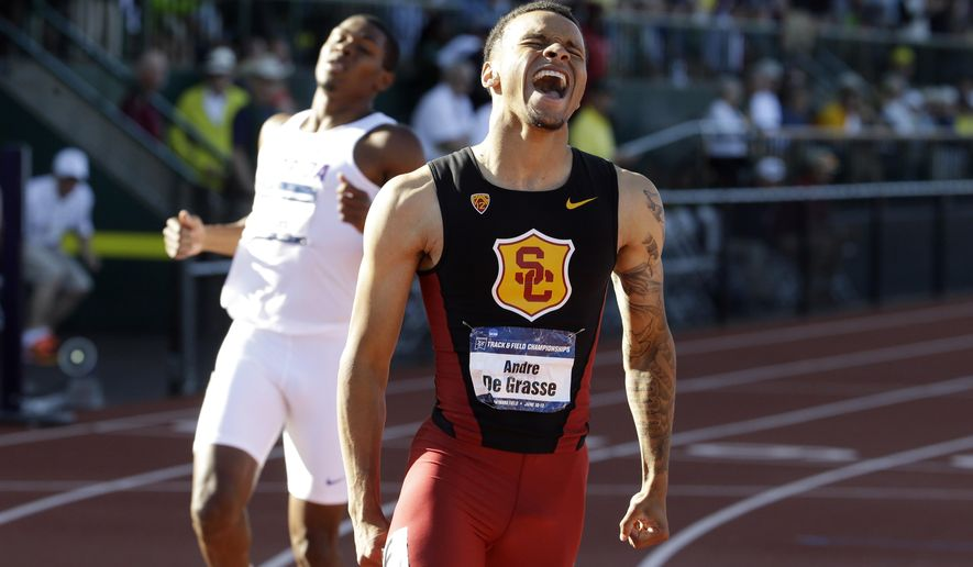 Southern California's Andre De Grasse reacts after winning the men's 200 meters during the NCAA track and field championships in Eugene, Ore., Friday, June 12, 2015. (AP Photo/Don Ryan)