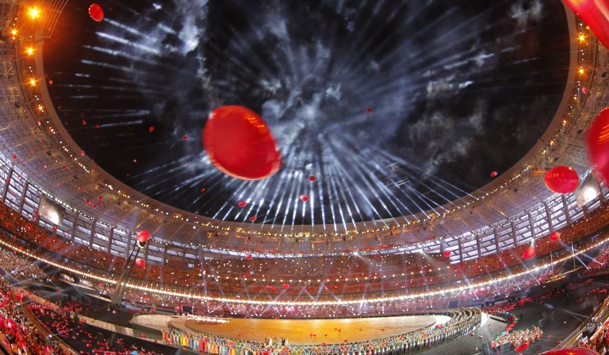 Fireworks explode over the stadium during the opening ceremony of the 2015 European Games in Baku, Azerbaijan, Friday, June 12, 2015. (AP Photo/Dmitry Lovetsky)