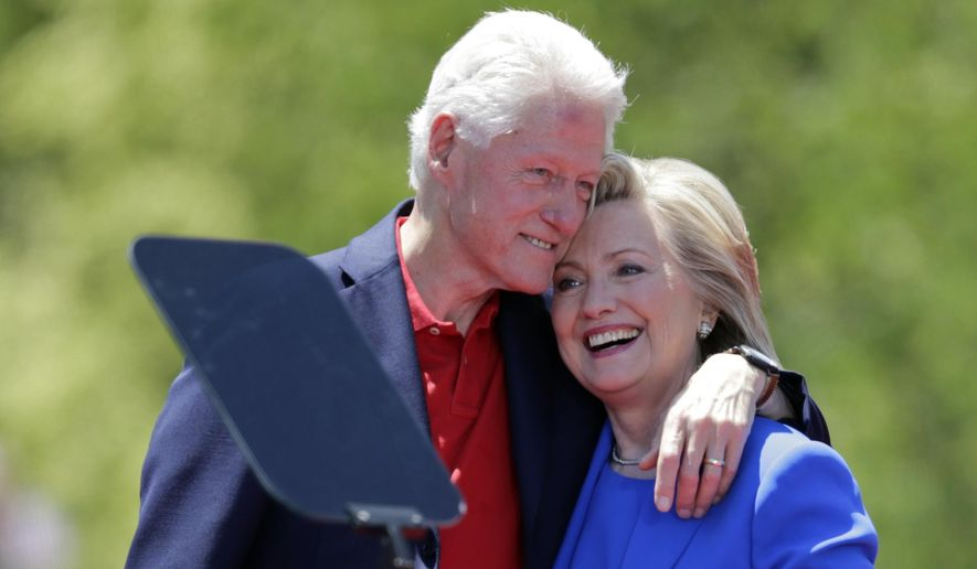 Democratic presidential candidate Hillary Rodham Clinton hugs her husband, former President Bill Clinton, after speaking to supporters June 13, 2015, on Roosevelt Island in New York. (Associated Press) **FILE**