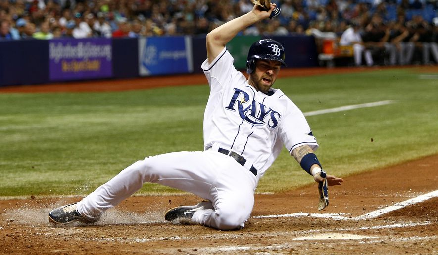 Tampa Bay Rays second baseman Nick Franklin (2) scores during the seventh inning of a baseball game Saturday, June 13, 2015, in St. Petersburg, Fla. (AP Photo/Luke Johnson)