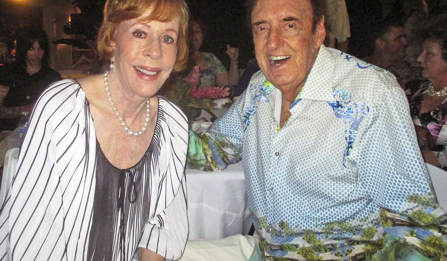 """In this Friday, June 12, 2015 photo, Jim Nabors and his friend and longtime collaborator in comedy Carol Burnett celebrate Nabors' 85th birthday with nearly 300 people at his home in Honolulu. Messages rolled in from across the nation for the man who portrayed Gomer Pyle on """"The Andy Griffith Show."""" Lt. Gen. John A. Toolan, Jr., commanding general of the United States Marine Corps Forces, Pacific, delivered congratulations from President Barack Obama. Nabors is also known as an ardent supporter of the U.S. Marine Corps, being one of only a handful of people to earn the official status of """"Honorary Marine."""" (John Berger/Honolulu Star-Advertiser via AP)"""