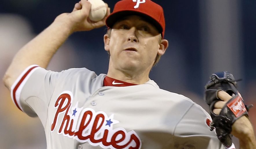 Philadelphia Phillies starting pitcher Kevin Correia throws to a Pittsburgh Pirates batter during the first inning of a baseball game Friday, June 12, 2015, in Pittsburgh. (AP Photo/Keith Srakocic)