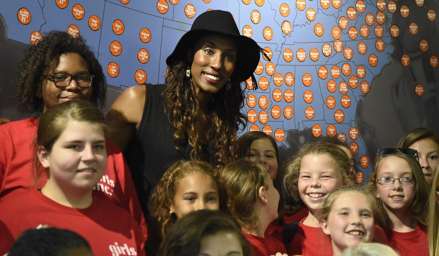 Lisa Leslie, former WNBA basketball player and 2015 Women's Basketball Hall of Fame inductee, center, poses for a photo with children during an autograph session at the Women's Basketball Hall of Fame on Saturday, June 13, 2015 in Knoxville, Tenn. (Adam Lau/Knoxville News Sentinel via AP)