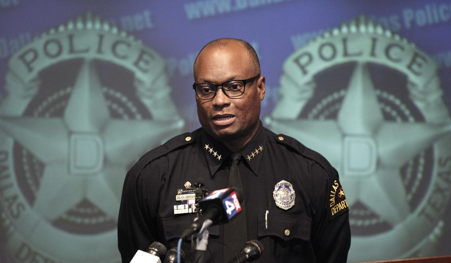 FILE - In this Nov. 17, 2011,  file photo, Dallas Police Chief David Brown speaks during a news conference at police headquarters in Dallas. Dallas police say one or more suspects opened fire on police headquarters early Saturday morning, June 13, 2015, rammed a police car and fled to a fast food restaurant just off interstate 45 outside the city where they are engaged in a standoff with police. Police Chief Brown tells a news confrerence that preliminary witness statements suggest there may have been other assailants firing from elevated locations.  (AP Photo/LM Otero, File)
