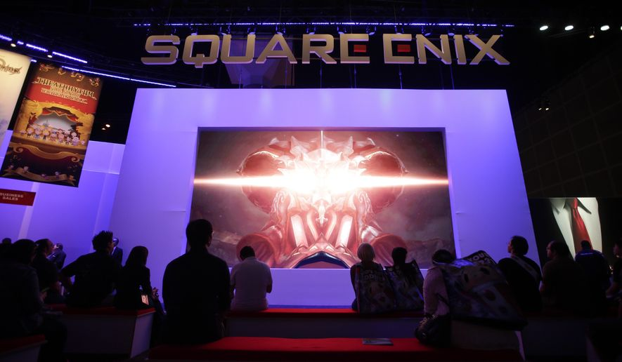 "FILE - In this June 10, 2014 file photo, people watch a video game trailer at the Square Enix booth at the Electronic Entertainment Expo, in Los Angeles.  Bethesda and Square Enix, makers of such video games as ""Fallout"" and ""Final Fantasy,"" are among the publishers angling to cut through the noise on the 2015 Electronic Entertainment Expo show floor to promote forthcoming titles by hosting their own flashy E3 briefings. The expo runs June 16-18, 2015, in Los Angeles.  (AP Photo/Jae C. Hong, File)"