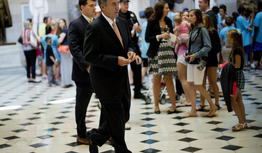 House Speaker John Boehner of Ohio walks in Statuary Hall on Capitol Hill in Washington toward the House Chamber, Friday, June 12, 2015. The House sidetracked a high-profile White House-backed trade bill, a humiliating defeat for President Barack Obama inflicted by Democratic Leader Nancy Pelosi and dozens of rank-and-file lawmakers from his own party. (AP Photo/Pablo Martinez Monsivais)