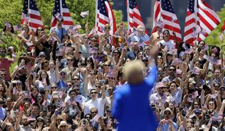 Democratic presidential candidate, former Secretary of State Hillary Rodham Clinton waves to supporters Saturday, June 13, 2015, on Roosevelt Island in New York.  (AP Photo/Frank Franklin II)