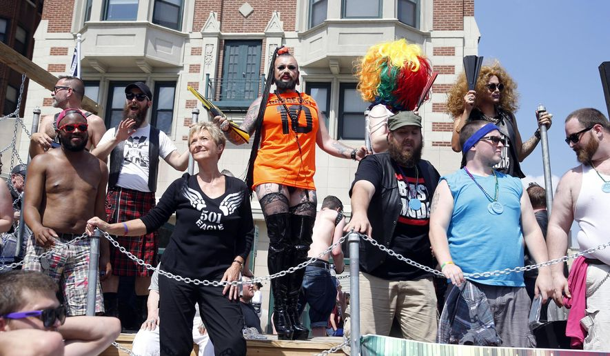 Parade participants ride on  a float as part of Circle City Pride activities in Indianapolis, Saturday, June 13, 2015. (AP Photo/AJ Mast)