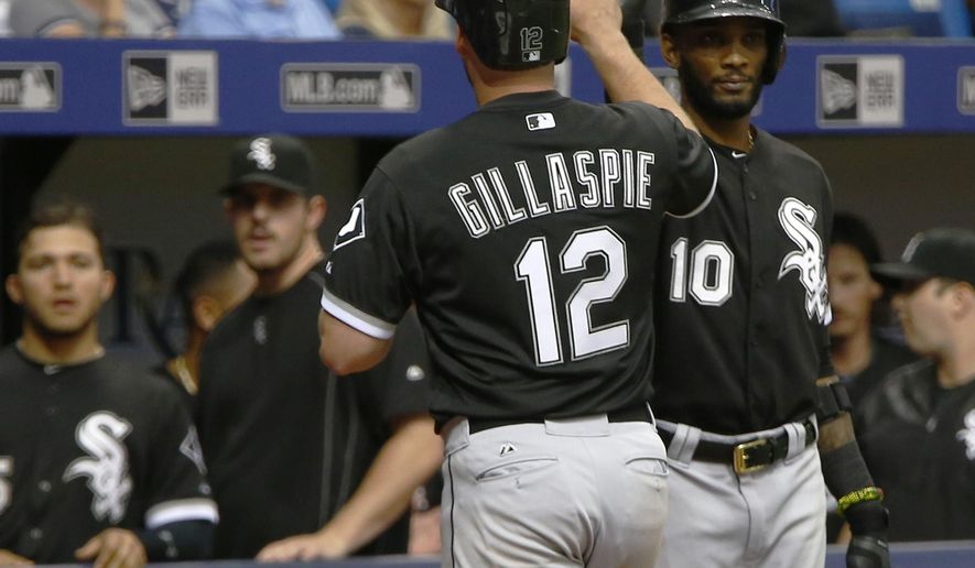 Chicago White Sox third baseman Conor Gillaspie (12), celebrates with shortstop Alexei Ramirez (10) after hitting a two run home run against the Tampa Bay Rays during the eighth inning of a baseball game Saturday, June 13, 2015, in St. Petersburg, Fla. (AP Photo/Luke Johnson)