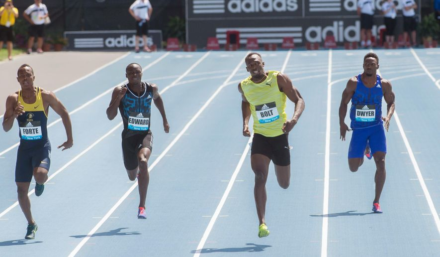 Jamaican sprinter and world record holder Usain Bolt, second from right, crosses the finish line ahead of Julian Forte, left, also of Jamaica, Alonso Edward, second from left, of Panama, and Rasheed Dwyer, also of Jamaica, as he wins men's 200 meters at the Adidas Grand Prix, Saturday, June 13, 2015, in New York. (AP Photo/Bryan R, Smith)
