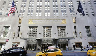 A taxi passes in front of the fabled Waldorf Astoria hotel in New York in this Oct. 6, 2014, file photo. (AP Photo/Mark Lennihan, File)