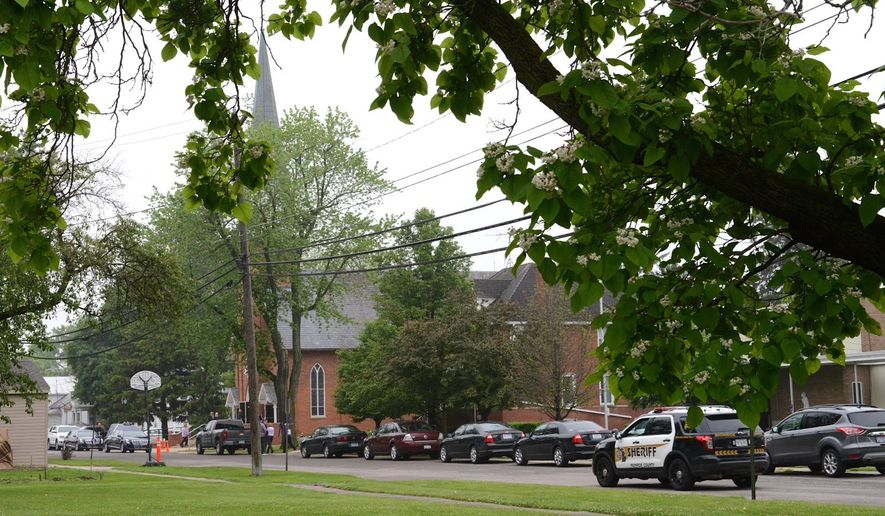 Cars line up outside Divine Grace Parish for funeral services for Chelsea Bruck in Ash Township, Mich. on Saturday, June 13, 2015.  Bruck went missing on Oct. 26 after a Halloween party in Frenchtown Township. Her remains were found April 24 in a wooded area off  in Ash Township. (Tom Hawley/The Monroe Evening News via AP)