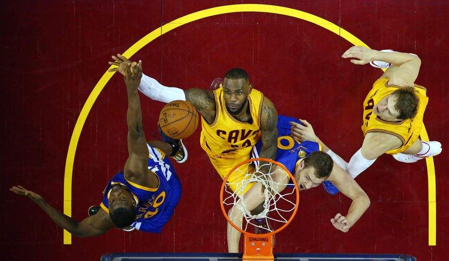 Cleveland Cavaliers forward LeBron James (23) left center, goes up for a rebound with Golden State Warriors forward Harrison Barnes (40), left, and forward David Lee (10) during the second half of Game 4 of basketball's NBA Finals in Cleveland, Thursday, June 11, 2015. Cleveland Cavaliers center Timofey Mozgov (20) is at the right. The Warriors defeated the Cavaliers 103-82 to tie the best-of-seven game series at 2-2.  (AP Photo/Ronald Martinez/Pool via AP)