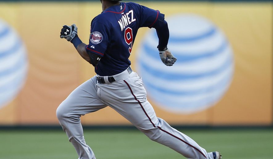Minnesota Twins' Eduardo Nunez runs to second on his double against the Texas Rangers during the ninth inning of a baseball game, Saturday, June 13, 2015, in Arlington, Texas. The Rangers won 11-7. (AP Photo/Jim Cowsert)