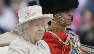 """Britain's Queen Elizabeth II and Prince Philip ride in a carriage during the Trooping The Colour parade at Buckingham Palace, in London, Saturday, June 13, 2015. Hundreds of soldiers in ceremonial dress have marched in London in the annual Trooping the Color parade to mark the official birthday of Queen Elizabeth II. The Trooping the Color tradition originates from preparations for battle, when flags were carried or """"trooped"""" down the rank for soldiers to see. (AP Photo/Tim Ireland)"""