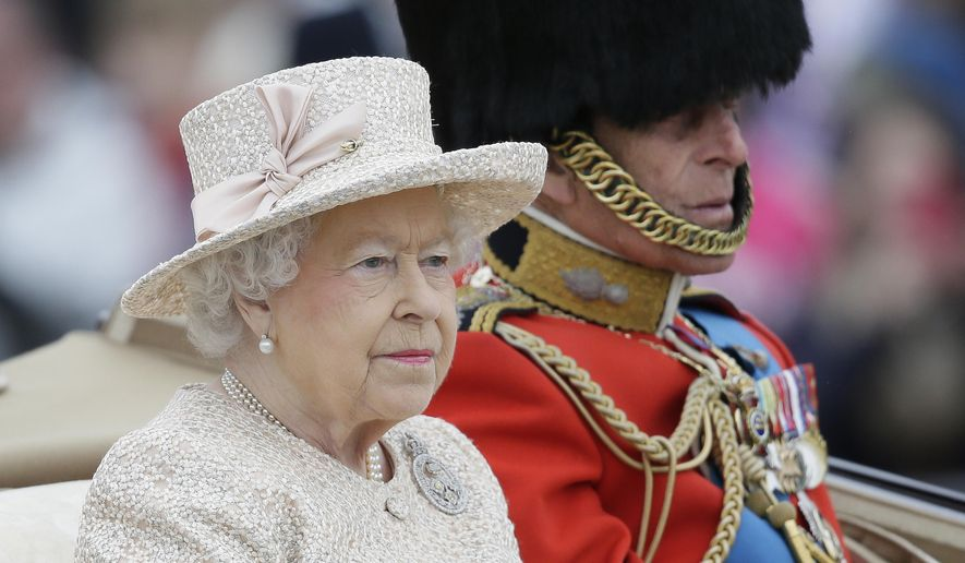 "Britain's Queen Elizabeth II and Prince Philip ride in a carriage during the Trooping The Colour parade at Buckingham Palace, in London, Saturday, June 13, 2015. Hundreds of soldiers in ceremonial dress have marched in London in the annual Trooping the Color parade to mark the official birthday of Queen Elizabeth II. The Trooping the Color tradition originates from preparations for battle, when flags were carried or ""trooped"" down the rank for soldiers to see. (AP Photo/Tim Ireland)"