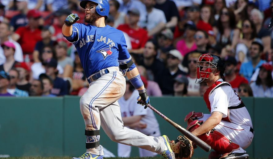 Toronto Blue Jays' Russell Martin watches his solo home run against the Boston Red Sox during the 11th inning of a baseball game at Fenway Park in Boston Saturday, June 13, 2015. (AP Photo/Winslow Townson)
