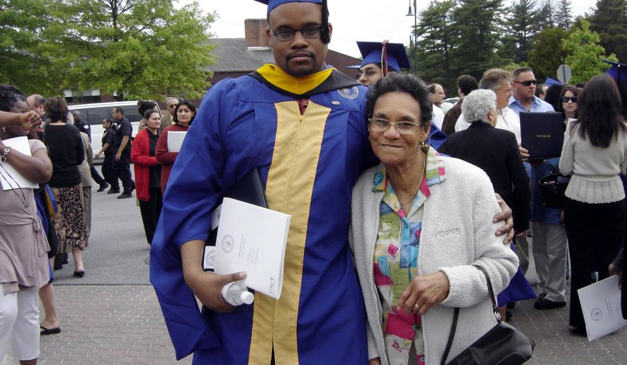 In this photo taken on June 19, 2007, released by Jennifer Young, her son Jermaine McBean poses with his grandmother Sylvia Mc Donald at McBean's graduation from Pace University, in New York.  McBean was shot by a Broward County Sheriff Deputy after several people called 911 to report a suspicious person carrying a gun down a busy street. McBean was carrying an air rifle when he was shot while entering an apartment complex, where he lived in Florida. (Jennifer Young via AP)