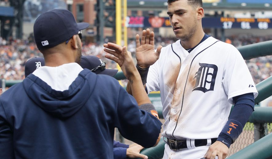 Detroit Tigers' Jose Iglesias, right, is congratulated by pitcher David Price after scoring against the Cleveland Indians on a double by Rajai Davis during the fourth inning of a baseball game Saturday, June 13, 2015, in Detroit. (AP Photo/Duane Burleson)