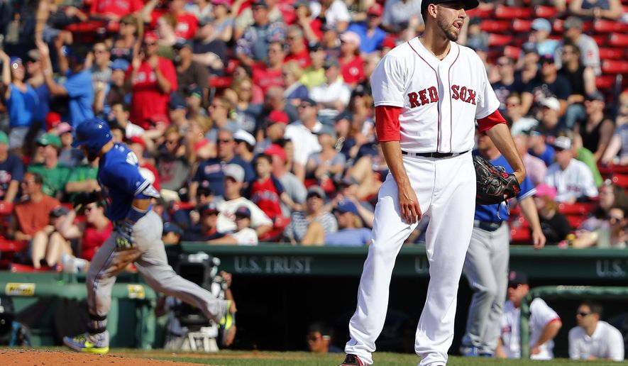 Boston Red Sox relief pitcher Matt Barnes stands on the mound after giving up the winning home run to Toronto Blue Jays' Russell Martin, left, during the 11th inning of Toronto's 5-4 win in a baseball game at Fenway Park in Boston Saturday, June 13, 2015. (AP Photo/Winslow Townson)