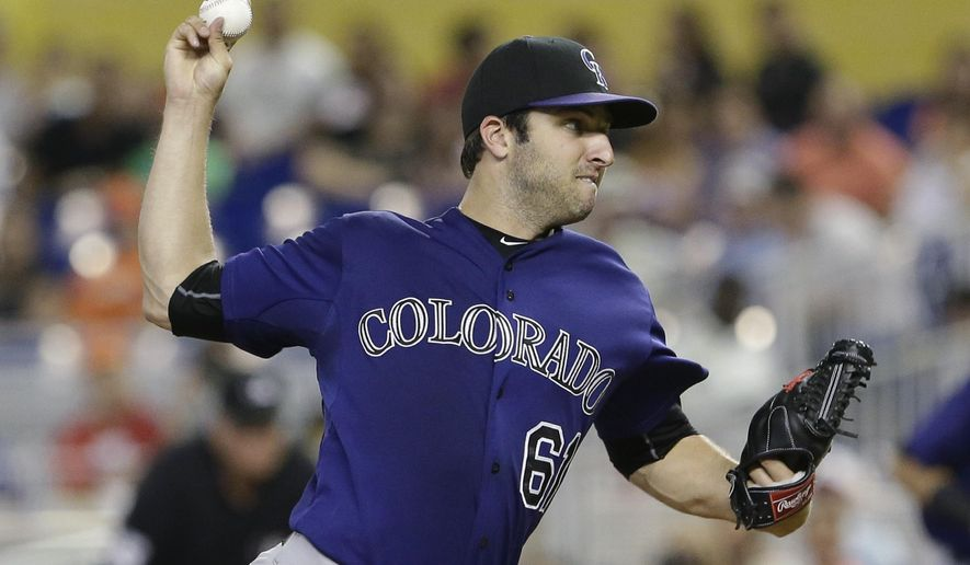 Colorado Rockies' David Hale delivers a pitch during the first inning of a baseball game against the Miami Marlins, Saturday, June 13, 2015, in Miami. The Marlins defeated the Rockies 4-1. (AP Photo/Wilfredo Lee)